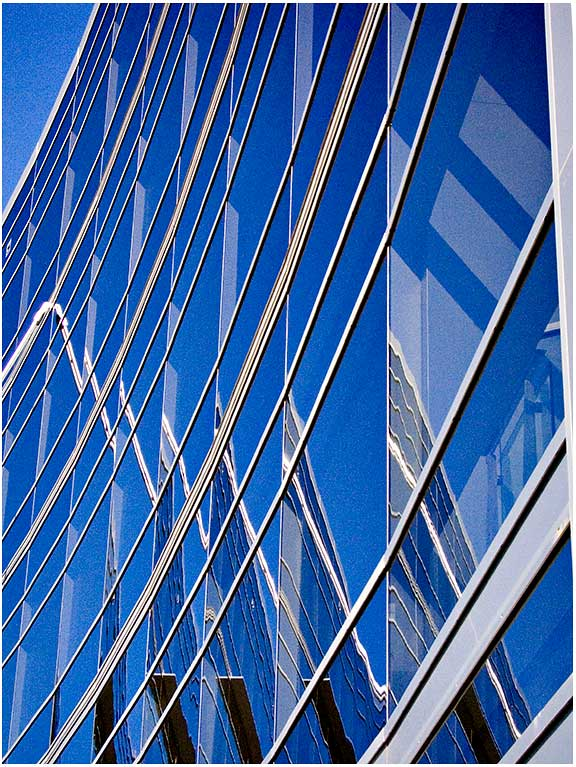Concave blue glass facade