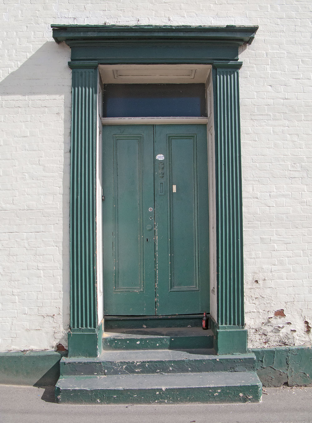 A victorian green door on wellington street